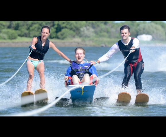 An Escape to the Lake 2016 skier gets help from two Aberdeen (S.D.) Aqua Addicts side skiers on June 18 at Nelson Lake near Center, N.D.