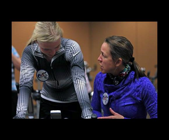 Class instructor Karen Lauer has a pre-class word with cyclist Andrea Rushford.