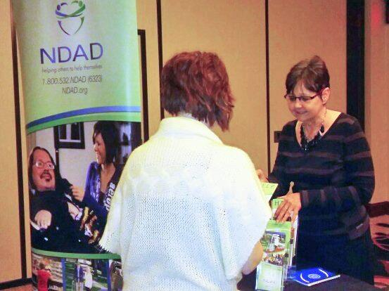 NDAD's Marsha Dupré chats with a woman who attended the Independent Living Fair in Minot in November 2016.