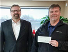 NDAD CEO Don Santer (right) receives a grant for NDAD's HELP program from Kevin Dvorak, president and CEO of the North Dakota Community Foundation.